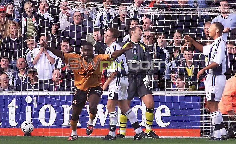 Pix: Ben Duffy....West Brom v Wolves..Nationwide Div.1 31/10/99...COPYWRIGHT PICTURE>>SIMON WILKINSON>>01943 436649>>..Agony for West Broms keeper and defence as Wolves  Akenbiyi celebrates