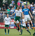 Jon Daly wins a header in the box