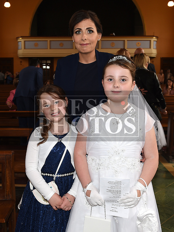 Alanah Donnelly from St Brigids school who recieved first holy communion in Our Lady of Lourdes church with mother Elaine and sister Grace. Photo:Colin Bell/pressphotos.ie