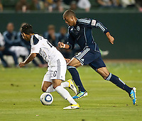 CARSON, CA – May 14, 2011: LA Galaxy defender AJ DeLaGarza (20) and Sporting KC forward Teal Bunbury (9) race to the ball during the match between LA Galaxy and Sporting Kansas City at the Home Depot Center in Carson, California. Final score LA Galaxy 4, Sporting Kansas City 1.