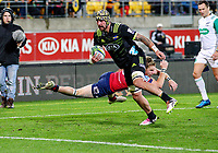 Hurricanes' Blade Thomson scores during the Super Rugby match between the Hurricanes and Reds at Westpac Stadium in Wellington, New Zealand on Friday, 18 May 2018. Photo: Mike Moran / lintottphoto.co.nz