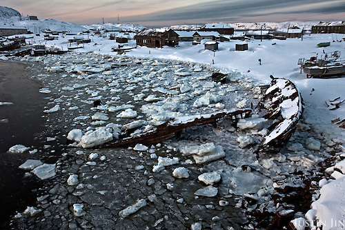 Sunken boats and abandoned houses lay rotting by an icy bay in Teriberka, a former prosperous fish-processing community waiting for an economic boom through gas production. <br /> <br /> Teriberka rose to international fame in the last decade after Gazprom engineers discovered one of the largest gas fields off its shore.<br /> <br /> International oil and gas companies rushed to bid for rights to develop the Shtokman gas field with Gazprom. <br /><br /> However, the project has been put on ice after since the collapse of the gas prices.