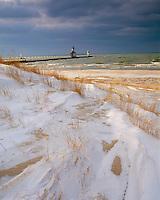 St. Joseph, MI <br /> St Joseph Pierhead Light from the windswept snow covered dunes of North Beach