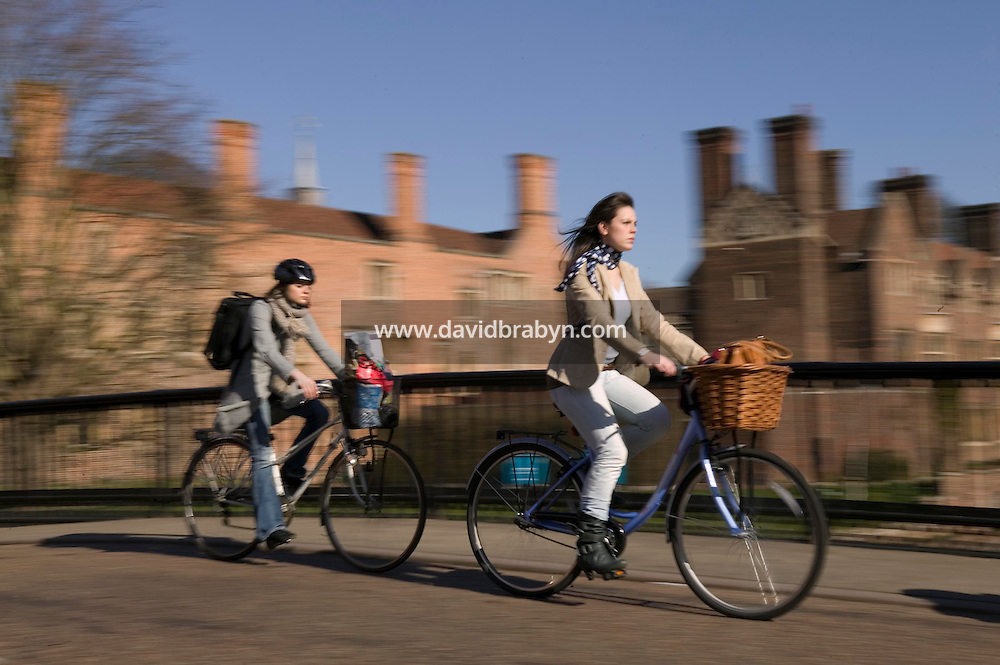 People cycle down Magdalene street and across a bridge over River Cam near Magdalene College in Cambridge, United Kingdom, 12 March 2007.