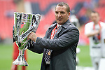 Swansea manager Brendan Rodgers pictured after being presented with the winners' trophy after the Npower Championship play-off final between Reading (blue) and Swansea City at Wembley Stadium. The match was won by Swansea by 4 goals to 2 watched by a crowd of 86,581. Swansea became the first Welsh team to reach the top division of English football since they themselves played there in 1983.