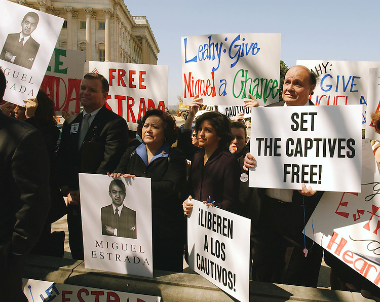 4/10/02.MIGUEL ESTRADA NOMINATION--Latino Coalition supporters hold signs during a news conference with Republican senators and House members on the nomination, before Senate Judiciary, of Miguel Estrada to be a federal circuit court judge.  .CONGRESSIONAL QUARTERLY PHOTO BY SCOTT J. FERRELL