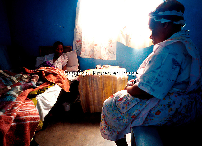 disiaids00269  Social Issues, Aids, Health. A mother at her daughters bedside in Gamalakhe in Southern Natal South Africa. The young woman is infected by the Aids virus and is very sick. South Africa has the highest increase of Aids in in the world. Poverty.©Per-Anders Pettersson/iAfrika Photos