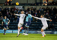 Adebayo Akinfenwa of Wycombe Wanderers shirt is pulled in the box by Stephen O'Donnell of Luton Town during the Sky Bet League 2 match between Wycombe Wanderers and Luton Town at Adams Park, High Wycombe, England on the 21st January 2017. Photo by Liam McAvoy.