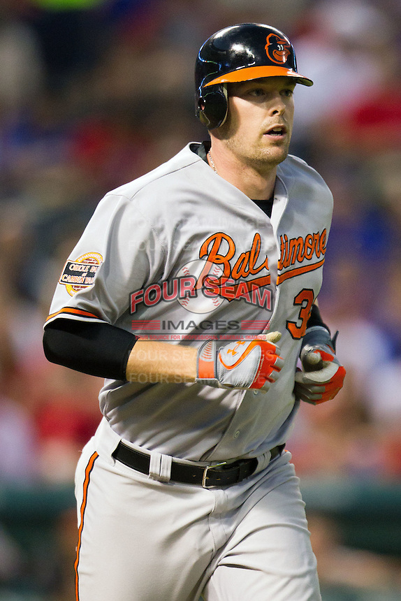 Baltimore Orioles catcher Matt Wieters #32 runs to first base during the Major League Baseball game against the Texas Rangers on August 21st, 2012 at the Rangers Ballpark in Arlington, Texas. The Orioles defeated the Rangers 5-3. (Andrew Woolley/Four Seam Images).