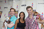 """Rory O'Malley, Nikki M. James, Andrew Rannells """"The Book of Mormon"""" attend Broadway Barks Lucky 13th Annual Adopt-a-thon - A """"Pawpular"""" Star-studded dog and cat adopt-a-thon on July 9, 2011 in Shubert Alley, New York City, New York with Bernadette Peters and Mary Tyler Moore as hosts.  (Photo by Sue Coflin/Max Photos)"""