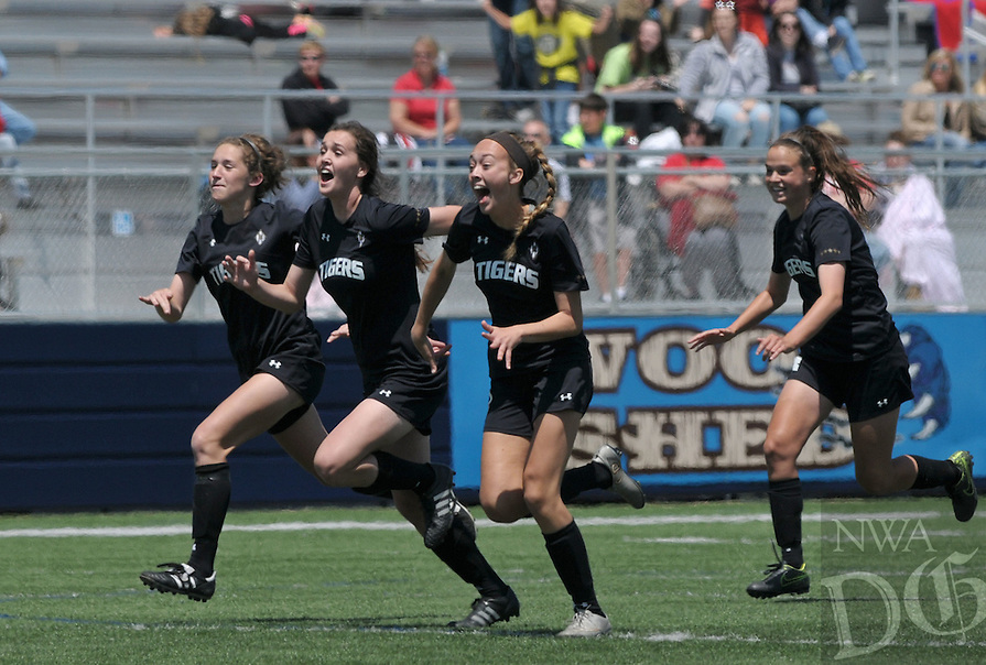 NWA Democrat-Gazette/BEN GOFF @NWABENGOFF<br /> Bentonville players celebrate on Saturday May 14, 2016 after defeating Bryant in PKs in the girls soccer class 7A state semifinal game at Springdale Har-Ber's Wildcat Stadium.