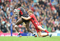 Kenya's Tonny Owuor Omoroh is tackled by Wales's Alex Webber<br /> <br /> Kenya Vs Wales - men's placing 5-8 match<br /> <br /> Photographer Chris Vaughan/CameraSport<br /> <br /> 20th Commonwealth Games - Day 4 - Sunday 27th July 2014 - Rugby Sevens - Ibrox Stadium - Glasgow - UK<br /> <br /> © CameraSport - 43 Linden Ave. Countesthorpe. Leicester. England. LE8 5PG - Tel: +44 (0) 116 277 4147 - admin@camerasport.com - www.camerasport.com