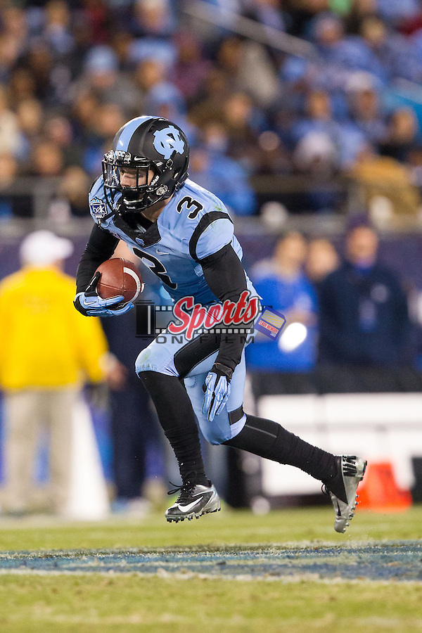 Ryan Switzer (3) of the North Carolina Tar Heels looks for running room after catching a pass against the Cincinnati Bearcats in the Belk Bowl at Bank of America Stadium on December 28, 2013 in Charlotte, North Carolina.  The Tar Heels defeated the Bearcats 39-17.   (Brian Westerholt/Sports On Film)