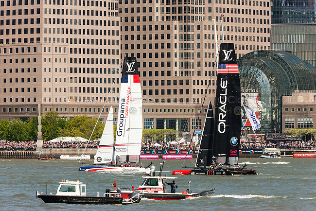 Louis Vuitton America's Cup World Series teams USA and France catamarans race on the Hudson River course near Brookfield Place.