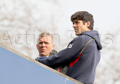 27.03.2014 Chelmsford, England.   Alastair Cook looks on from the players balcony with Alec Stewart during the Essex and Surrey Pre-Season Friendly match from The Essex County Ground, Chelmsford