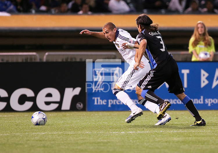 Bryan Jordan (27) controls the ball against Nick Garcia (3). San Jose Earthquakes tied Los Angeles Galaxy 1-1 at the McAfee Colisum in Oakland, California on April 18, 2009.