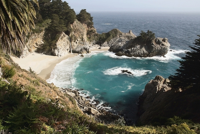 80 foot waterfall onto an inaccessable beach on the Big Sur coast of California.<br /> <br /> The waterfall used to fall directly into the ocean until the landscape was forever changed by a landslide in the 1980s.
