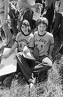 """28 Jun 1970, Manhattan, New York City, New York State, USA. Two young women wear matching t-shirts, one reading """"MASTER"""" and the other """"SLAVE."""" They are in Central Park taking part in New York's first Gay Pride celebration."""