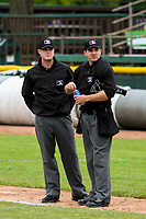 Umpires Taylor Payne (left) and Tanner Moore (right) between innings of a Midwest League game between the Quad Cities River Bandits and the Beloit Snappers on May 20, 2018 at Pohlman Field in Beloit, Wisconsin. Beloit defeated Quad Cities 3-2. (Brad Krause/Four Seam Images)