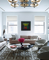 The family room is light and airy and has a relaxed feel. The custom sofa is upholstered in a Castel fabric.