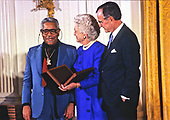 United States President George H.W. Bush and first lady Barbara Bush present the National Medal of Arts to American jazz trumpeter, bandleader, composer, and singer Dizzy Gillespie during a ceremony in the East Room of the White House in Washington, DC on November 19, 1989. <br /> Credit: Ron Sachs / CNP