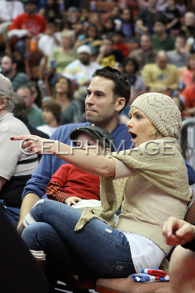 SIMRAN SINGH, DEZI JAMES CUBICHE, JAIME PRESSLY. Celebrities attend a basketball game featuring the Harlem Globetrotters at the Honda Center, Anaheim, CA, USA. February 13, 2010. .