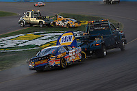 Apr 22, 2006; Phoenix, AZ, USA; Tow trucks remove the crashed cars of Elliott Sadler (38) and Michael Waltrip (55) during the Subway Fresh 500 at Phoenix International Raceway. Mandatory Credit: Mark J. Rebilas-US PRESSWIRE Copyright © 2006 Mark J. Rebilas..