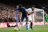 9th November 2019; Stamford Bridge, London, England; English Premier League Football, Chelsea versus Crystal Palace; James Tomkins of Crystal Palace challenges Tammy Abraham of Chelsea - Strictly Editorial Use Only. No use with unauthorized audio, video, data, fixture lists, club/league logos or 'live' services. Online in-match use limited to 120 images, no video emulation. No use in betting, games or single club/league/player publications