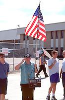 Teamsters veteran striker age 64 with radio & flag at the UPS strike.  Minneapolis Minnesota USA