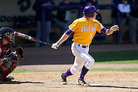 LSU Tigers first base Mason Katz #8 follows through on his swing against the Auburn Tigers in the NCAA baseball game on March 24, 2013 at Alex Box Stadium in Baton Rouge, Louisiana. LSU defeated Auburn 5-1. (Andrew Woolley/Four Seam Images).