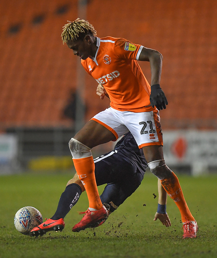 Blackpool's Armand Gnanduillet battles for the ball<br /> <br /> Photographer Dave Howarth/CameraSport<br /> <br /> The EFL Sky Bet League One - Blackpool v Doncaster Rovers - Tuesday 12th March 2019 - Bloomfield Road - Blackpool<br /> <br /> World Copyright © 2019 CameraSport. All rights reserved. 43 Linden Ave. Countesthorpe. Leicester. England. LE8 5PG - Tel: +44 (0) 116 277 4147 - admin@camerasport.com - www.camerasport.com