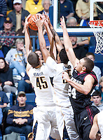 December 29th, 2012: California's David Kravish and Richard Solomon grabs the ball for a defensive rebound away from Harvard's Jonah Travis during a game at Haas Pavilion in Berkeley, Ca Harvard defeated California 67 - 62