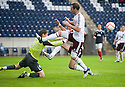 Falkirk's Michael McGowan punches clear from Andrew Webster and Ryan McGowan.