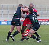 10th February 2019, AJ Bell Stadium, Salford, England; Betfred Super League rugby, Salford Red Devils versus London Broncos; Rob Lui of Salford Red Devils is tackled by Jay Pitts and Matty Gee of London Broncos