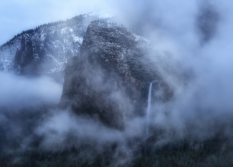 Fog swirling around Bridalveil Falls. Yosemite National Park, CA