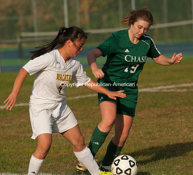 WATERBURY, CT--- -102115JS14---Chase's Sam Crone (19) looks to clear the ball in front of Ethel Walker's Amelie Gilles (5) during their game Wednesday at Chase Collegiate School in Waterbury. <br /> Jim Shannon Republican-American