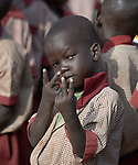 A boy gestures at a photographer in the Loreto Primary School outside Rumbek, South Sudan. The school is run by the Institute for the Blessed Virgin Mary--the Loreto Sisters--of Ireland.