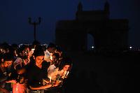 Mumbai residents takes part in a remembrance vigil next to Taj Mahal Hotel in Mumbai on the 3rd of December, 2008, Mumbai, India.