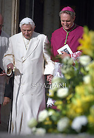 Pope emeritus Benedict XVI  with Pope Francis Monsignor Georg Gänswein.during a papal mass for elderly people at St Peter's square  at the Vatican.on September 28, 2014