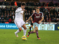Pictured L-R: Nelson Oliveira of Swansea against Mark Noble of West Ham Saturday 10 January 2015<br />