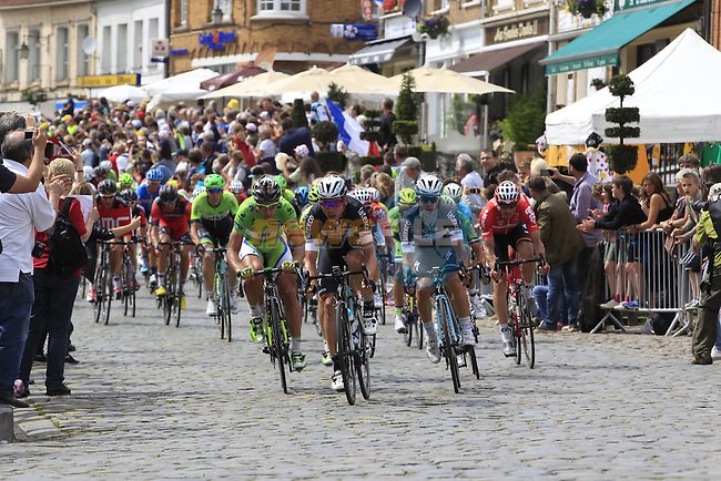 The peleton led by Tony Martin (GER) Omega Pharma-Quick Step and Peter Sagan (SVK) Cannondale pass through the ancient town of Cassel during Stage 4 of the 2014 Tour de France running 163.5km from Le Touquet to Lille. 8th July 2014.<br /> Picture: Eoin Clarke www.newsfile.ie