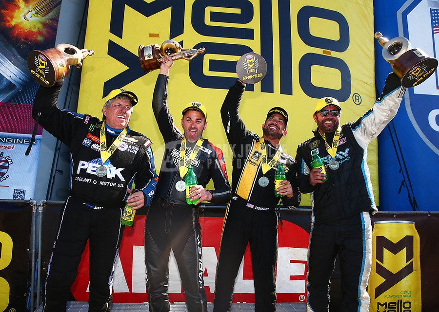 Mar 19, 2017; Gainesville , FL, USA; (from left) NHRA funny car driver John Force, pro stock motorcycle rider Eddie Krawiec , top fuel driver Tony Schumacher and pro stock driver Shane Gray celebrate after winning the Gatornationals at Gainesville Raceway. Mandatory Credit: Mark J. Rebilas-USA TODAY Sports