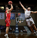 SIOUX FALLS, SD - MARCH 12:  Canaan Coffey #33 from Indiana Wesleyan spots up for a jumper over Bishop Smith #10 from IU East during their semifinal game at the 2018 NAIA DII Men's Basketball Championship at the Sanford Pentagon in Sioux Falls. (Photo by Dave Eggen/Inertia)