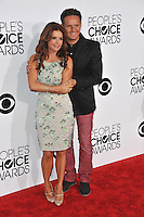 Producer Mark Burnett & wife Roma Downey at the 2014 People's Choice Awards at the Nokia Theatre, LA Live.<br /> January 8, 2014  Los Angeles, CA<br /> Picture: Paul Smith / Featureflash