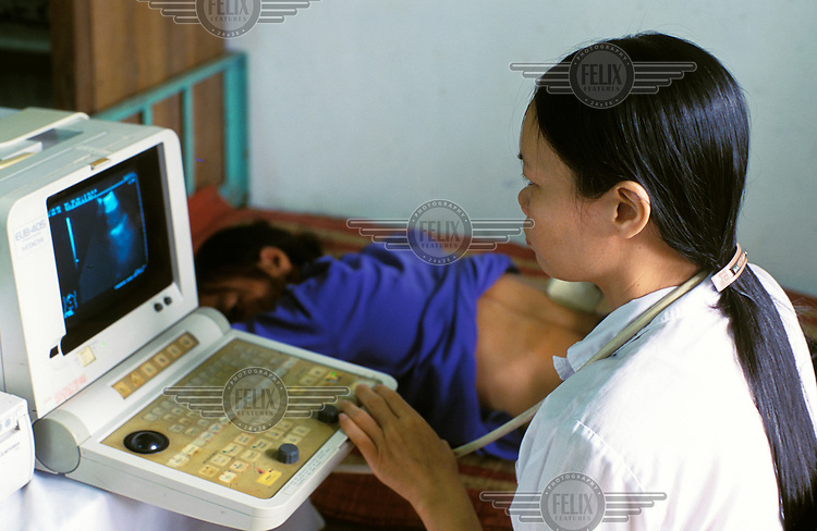 A pregnant woman receives an ultrasound examination at a communal health centre.