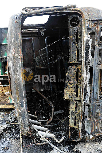 The wreckage of a burnt school bus is seen after it crashed in Damanhur November 5, 2014. At least 16 people, mostly children, were killed on Wednesday when the bus crashed into three other vehicles on a desert road in the Nile Delta north of Cairo, state television said. Eighteen people were also wounded in the crash and transported to hospital, a local health ministry official said. Photo by Stringer