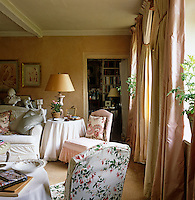 The intimate living room reflects a quintessential English country style with its combination of grandeur and shabby chic