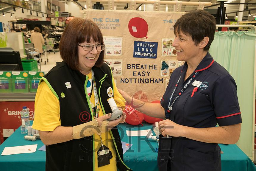Asda Community Champion Christine Conway tries the spirometer test with Specialist Respiratory Nurse Alison Sutherland