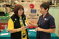 Asda Community Champion Christine Conway tries the spirometer test with Specialist Respiratory Nurse Alison Sutherland