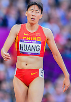 August 05, 2012: Xiaoxiao Huang of CHN reacts after competing in the round one of women's 400m hurdles at the Olympic Stadium on day nine of 2012 Olympic Games in London, United Kingdom.